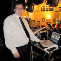 Photo of DJ David Graham behind the rig