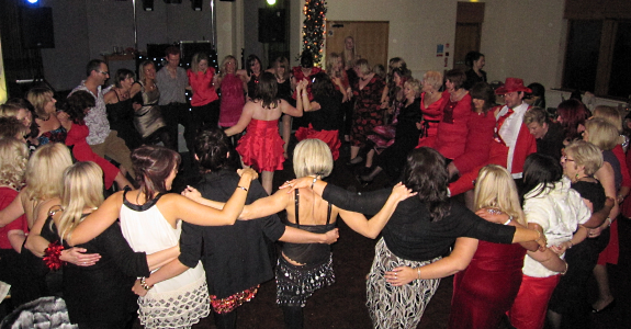 Guests dancing at a disco at Mere Brow Village Hall, near Southport / Preston