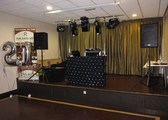 Setup on stage, ready to DJ for a 21st at The Ratcliffe Bars & Function Suites, next to Rochdale Football Club, in Rochdale